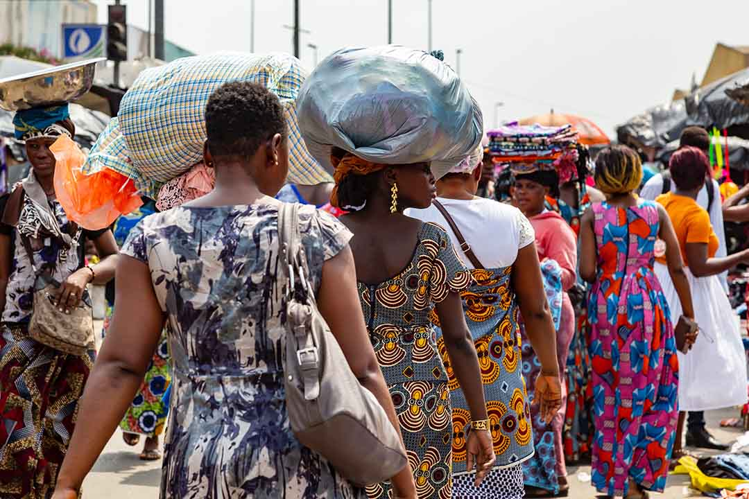 locals walking through Adjamé Market, abidjan, ivory coast