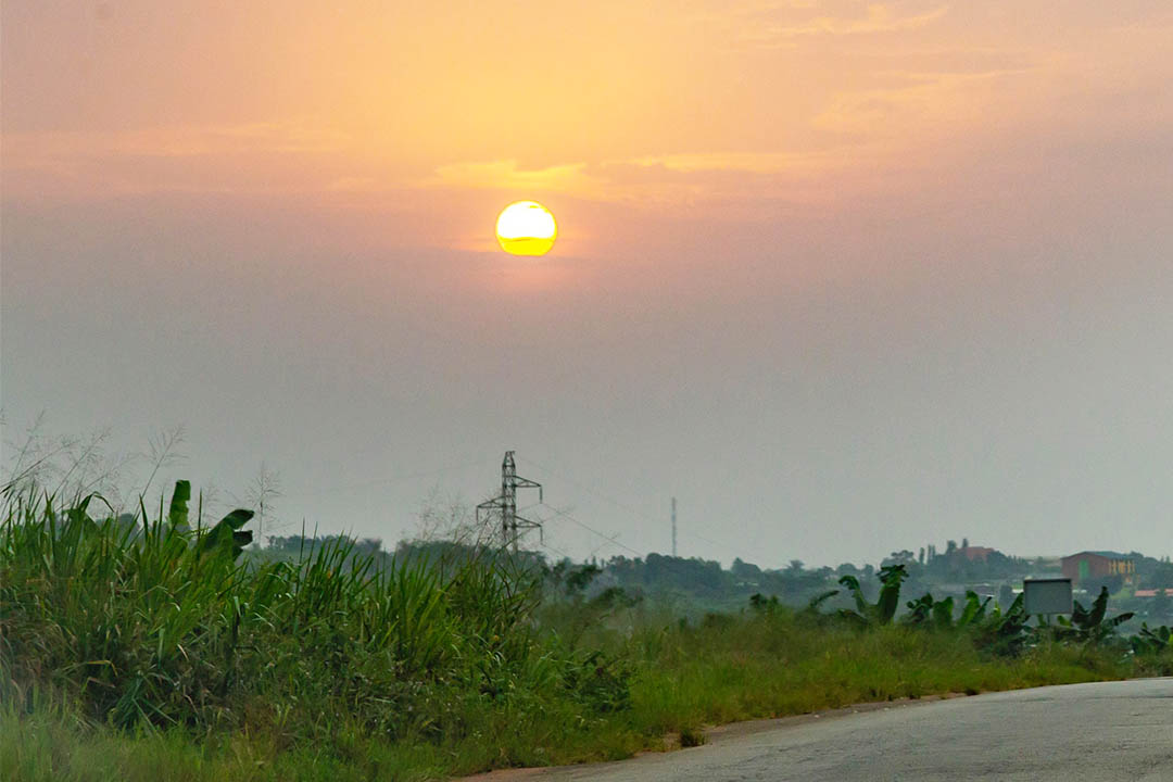 The sun setting over a field in the Ivory Coast