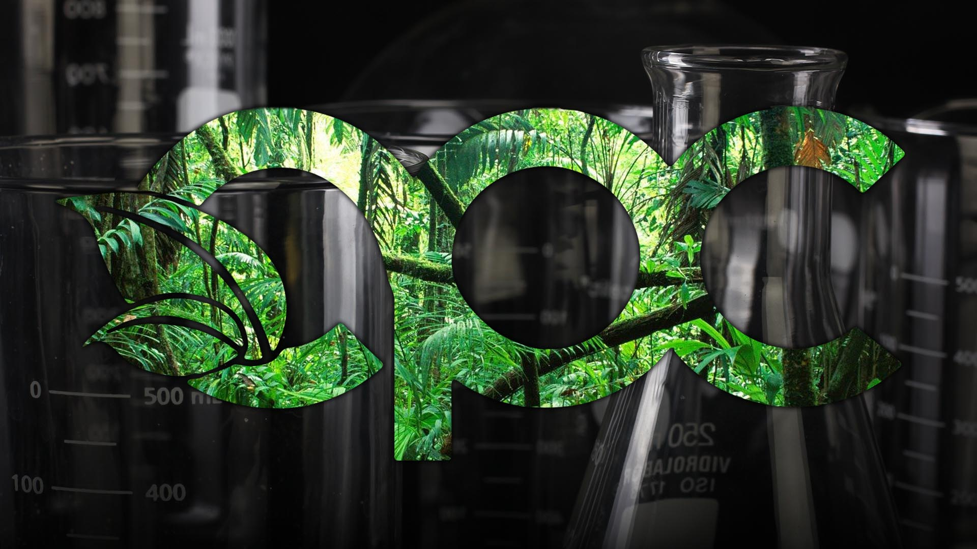 Jungle knockout on glass beaker background in the shape of OPC logo